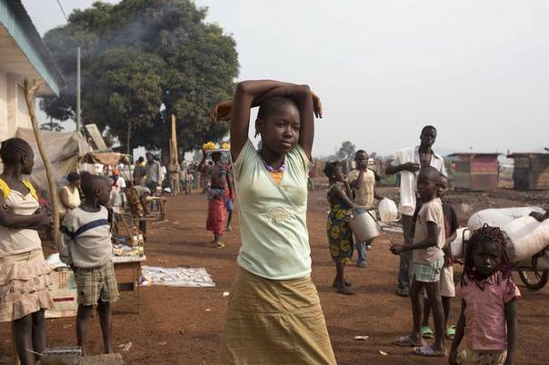 A woman stands in a camp for displaced people at M'poko International Airport in Bangui February 26, 2014. REUTERS/Camille Lepage
