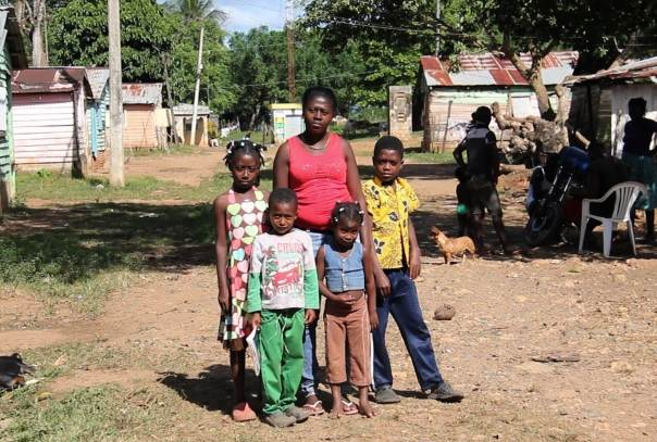Juliana Deguis and her family pictured near their home in Monte Plata, 45km northeast of Dominican Republic's capital Santo Domingo. Photo courtesy of rights group MOSCTHA