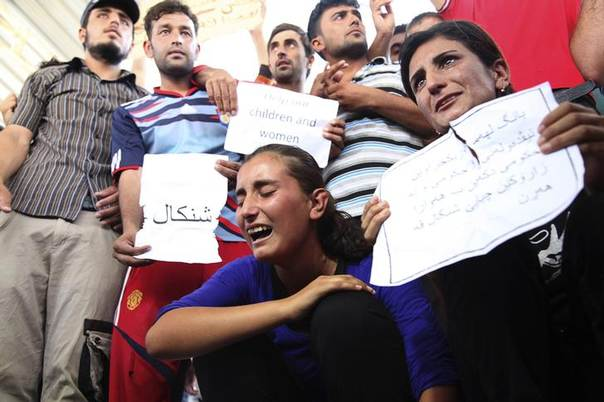 Displaced demonstrators from the minority Yazidi sect gather during a protest against militants of the Islamic State, formerly known as the Islamic State in Iraq and the Levant (ISIL), in Arbil, north of Baghdad August 4, 2014. REUTERS/Azad Lashkari
