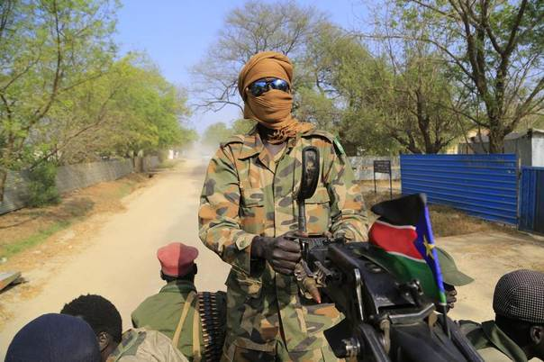 A South Sudan army soldier mans a machine gun mounted on a truck in a street in Malakal town, 497 km (310 miles) northeast of the capital Juba, December 30, 2013. REUTERS/James Akena