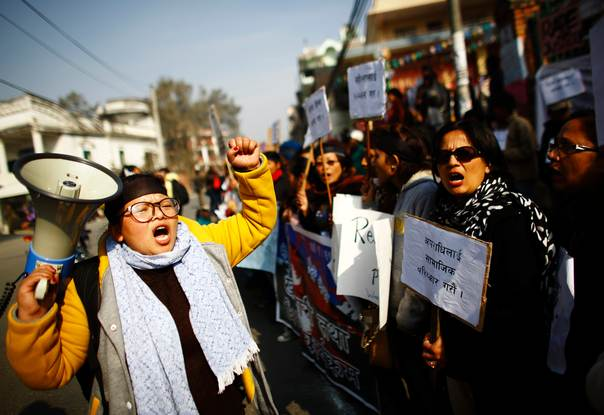 Nepalese women protest against an increase in violence against women and demand the government implement stronger laws, outside the Prime Minister's official residence in Kathmandu. Picture January 7, 2013, REUTERS/Navesh Chitrakar