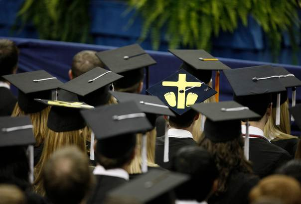 In a file photo from 2009, a student wears a mortarboard with a symbol for an aborted foetus, during a commencement address by U.S. President Barack Obama at the University of Notre Dame in South Bend, Indiana. REUTERS/John Gress