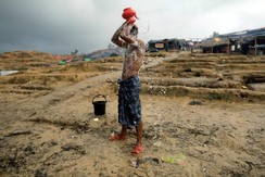 A Rohingya refugee washes in a refugee camp in Cox's Bazar