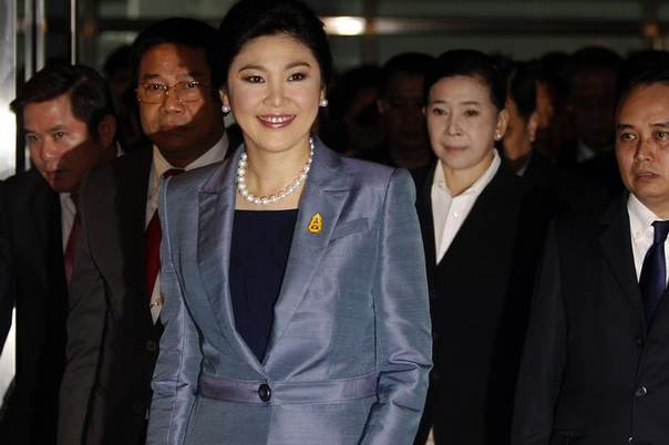 Thailand's Prime Minister Yingluck Shinawatra smiles as she arrives at the Constitutional Court in Bangkok May 6, 2014 REUTERS/Chaiwat Subprasom
