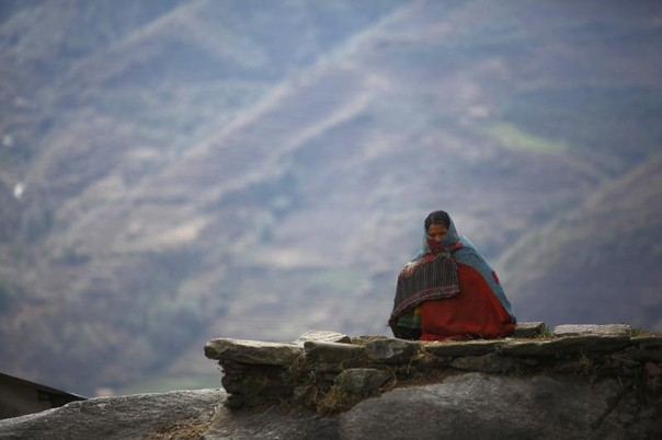 Surja Devi Saud, 20, who practices Chaupadi, sits outside her house in Achham District in western Nepal February 16, 2014. REUTERS/Navesh Chitrakar
