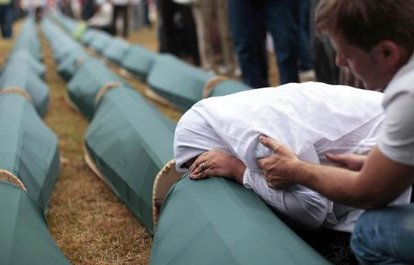 A Bosnian Muslim woman cries on the coffin of a relative during a mass funeral for victims killed during 1992-1995 war in Bosnia, whose remains were found in mass graves around the town of Prijedor and Kozarac, 50 km (31 miles) northwest of Banja Luka, Bosnia and Herzegovina, July 20, 2011. REUTERS/Dado Ruvic