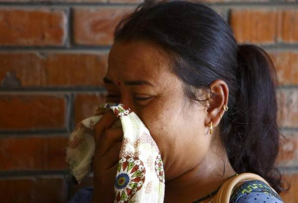 A woman cries at a hospital in Kathmandu, where her loved ones are undergoing treatment after being rescued from a landslide in northeast Nepal, August 2, 2014. REUTERS/Navesh Chitrakar