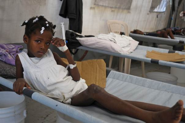 In a 2012 file photo, a young girl diagnosed with cholera cries while being treated at a medical center run by Medecins Sans Frontieres (Doctors Without Borders) outside of Port-au-Prince, on Nov. 1, 2012. REUTERS/Swoan Parker