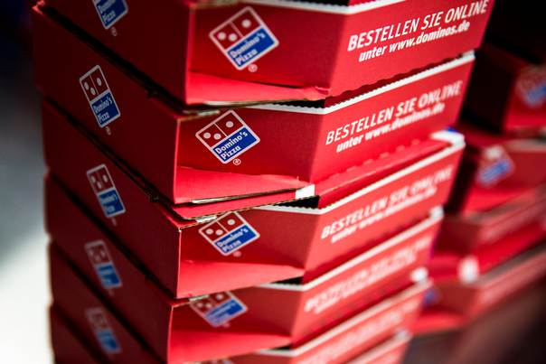 Delivery boxes for take-away pizzas are stacked at a Domino's Pizza store in Berlin, on August 19, 2013. REUTERS/Thomas Peter