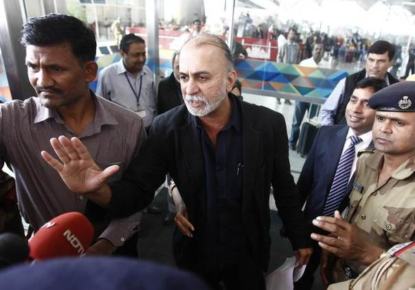 Tarun Tejpal, editor-in-chief of India's leading investigative magazine Tehelka, who denies accusations that he sexually assaulted a colleague, speaks with the media at New Delhi airport. Photo November 29, 2013, REUTERS/Anindito Mukherjee