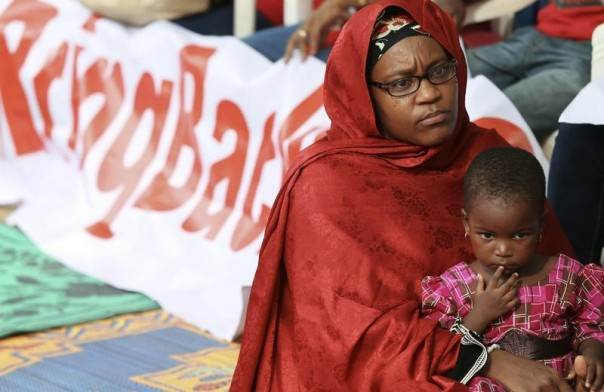 A mother and her daughter join protesters in a sit-in protest demanding the release of abducted secondary school girls in the remote village of Chibok, in Abuja, Nigeria, May 10, 2014. REUTERS/Afolabi Sotunde