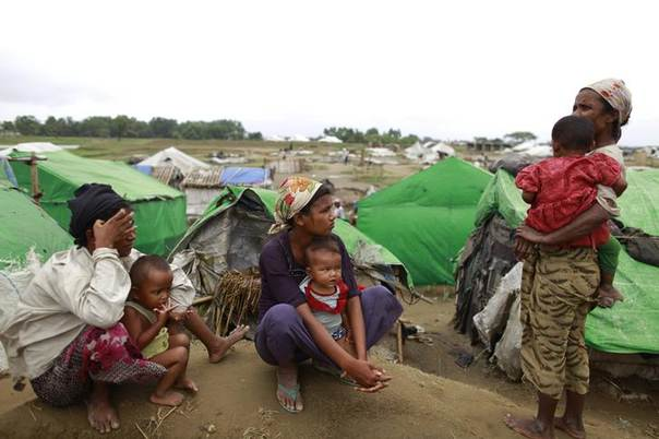 Mothers are pictured with their children at a Rohingya internally displaced persons (IDP) camp outside Sittwe, May 16, 2013. REUTERS/Soe Zeya Tun