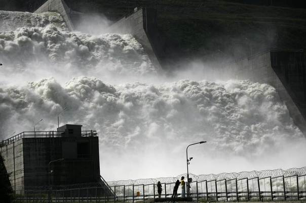 Visitors look at a spillway at the Sayano-Shushenskaya hydro electric power station, 520 km (320 miles) south of Russia's Siberian city of Krasnoyarsk, August 22, 2013. The spillway was constructed as an emergency outlet in case of a technical failure and as a high water dump device on the Yenisei River. REUTERS/Ilya Naymushin