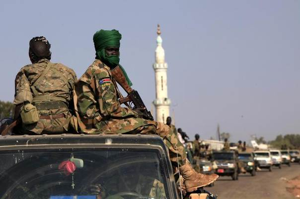 SPLA soldiers sit at the back of a pick-up truck in Bentiu, Unity state January 12, 2014 REUTERS/Andreea Campeanu
