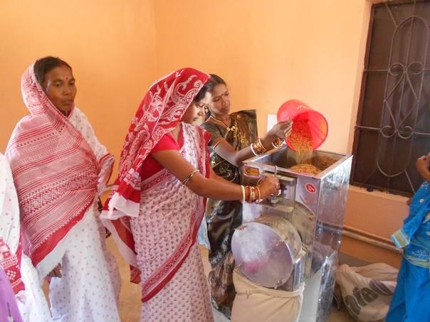 Self Help Group members in Bausadiha village engaged in grinding of Chatua. (Courtesy, TERI)