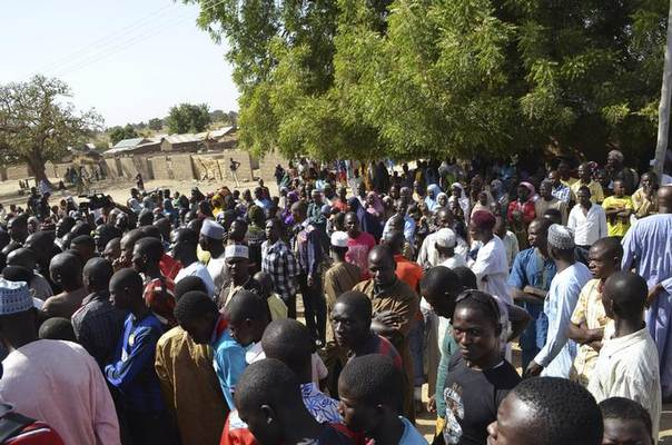 People displaced by violence and unrest due to an insurgency by Boko Haram, who want to carve a breakaway Islamic state out of largely Muslim northern Nigeria, are seen in this Feb 18, 2014 archive photo. Witnesses said the insurgents killed at least 68 villagers this week. REUTERS/Stringer