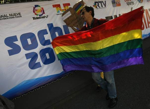 A member of the LGBT community holds a rainbow flag during a demonstration against discrimination due to sexual orientation at the Sochi Winter Olympic Games, outside the Russian embassy in Mexico City February 5, 2014. REUTERS/Bernardo Montoya