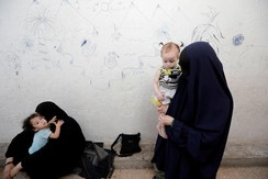 Zarima (R) from Chechnya, wife of a former Islamic State fighter, is pictured as she holds her daughter at a camp for displaced people in Ain Issa, north of Raqqa, Syria