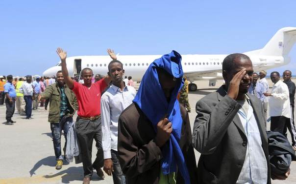 Somali nationals deported from Kenya arrive at the airport in Somalia's capital Mogadishu, April 9, 2014. REUTERS/Feisal Oma