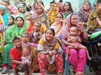 Push to ward off disasters in Dhaka slum deters early marriage