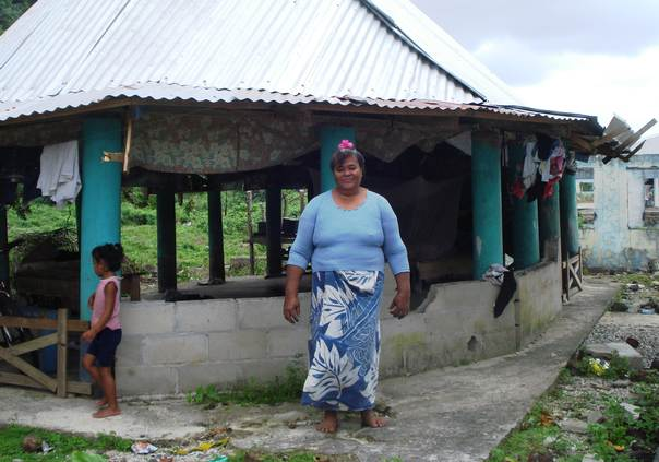 Faititili Fuatagaumu stands in front of her house in Saleapaga village on Samoa's Upolu Island, which was destroyed by a tsunami in 2009. TRF/Catherine Wilson