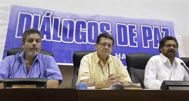 Revolutionary Armed Forces of Colombia (FARC) lead negotiator Ivan Marquez (R) speaks to the media beside fellow negotiators Pablo Catatumbo (C) and Marcos Carratala during a conference between Colombia's government and FARC in Havana June 7, 2014. REUTERS/Enrique De La Osa