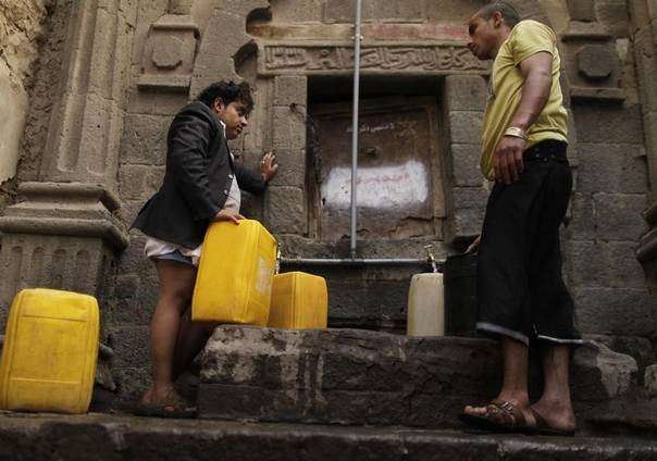 People fill jerrycans with water at a public tap in the Old Sanaa city, Yemen, February 24, 2014. REUTERS/Khaled Abdullah