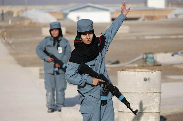 A female Afghan National Police (ANP) officer gives instructions during a patrol training session, at a training centre near the German Bundeswehr army camp in Kunduz, northern Afghanistan December 3, 2012. REUTERS/Fabrizio Bensch