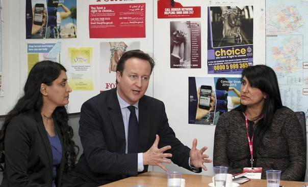 British Prime Minister David Cameron speaks with Aneeta Prem from Freedom Charity (L) and Jasvinder Sanghera of Karma Nirvana, during a meeting with the forced marriage unit in the Foreign Office in London. Picture June 8, 2012. REUTERS/Jon Bond/Pool