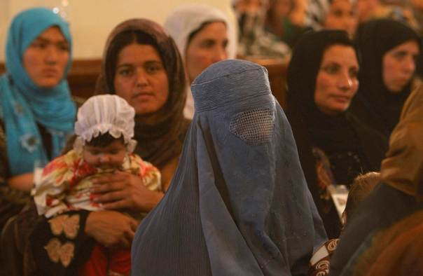 Women listen to a speech by Afghanistan's President Hamid Karzai during a district assembly gathering, in Kabul May 30, 2013. REUTERS/Omar Sobhani