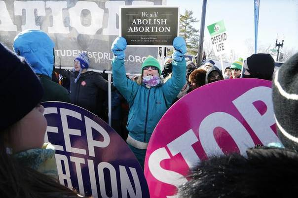 An anti-abortion demonstrator (C) shouts at pro-choice demonstrators in front of the U.S. Supreme Court during the annual March for Life in Washington, January 22, 2014 REUTERS/Jonathan Ernst