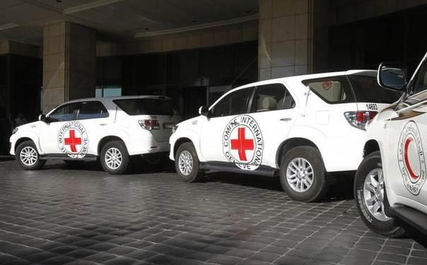 This Sept. 4 file photo shows vehicles waiting to transport Peter Maurer, president of the International Committee of the Red Cross (ICRC), for a meeting with Syria's President Bashar al-Assad in Damascus. REUTERS/Khaled al-Hariri